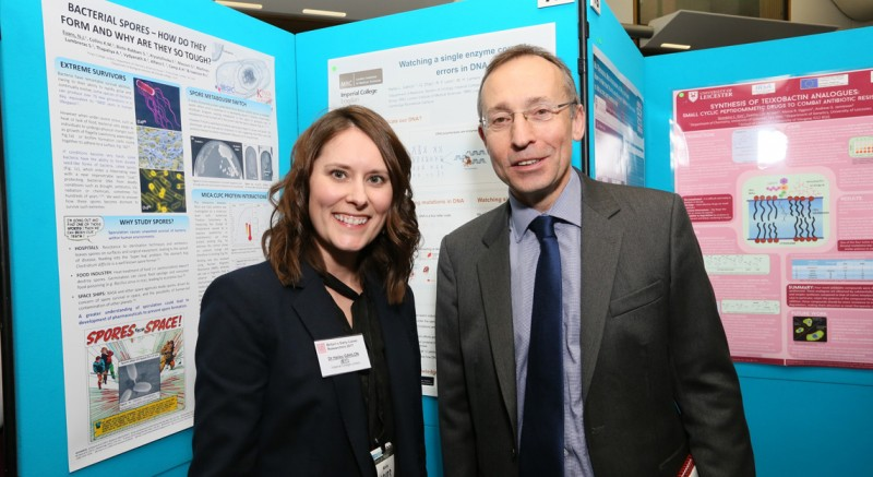 Local policitian Andy Slaughter (right) learns about Hailey Gahlon's research